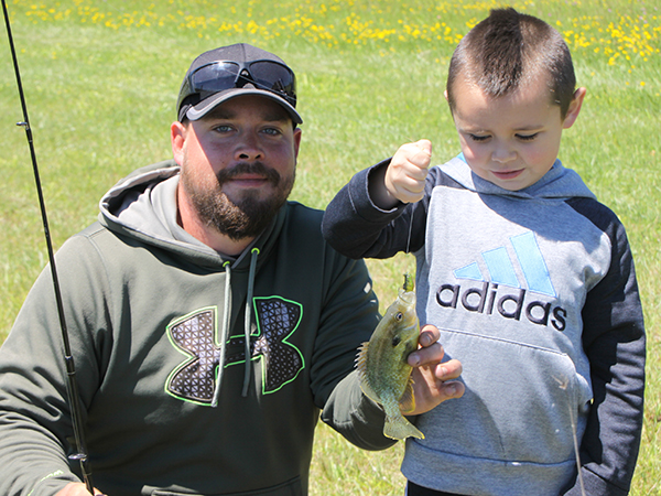Kyle Costello Of Lockport With His Son Parker Fishing A Farm Pond.