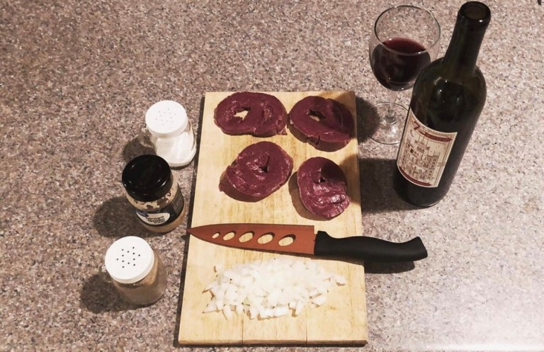 Prepping ingredients for recipe using venison heart_Outdoor News Taste of the Wild