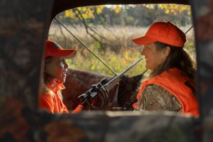 A Mother And Her Daughter Inside Of A Hunting Blind Talking While Deer Hunting.