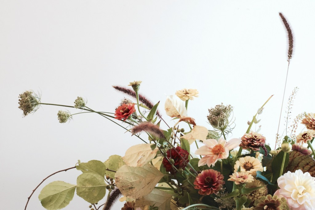 A bouquet of local zinnia and dahlia with other locally foraged materials.