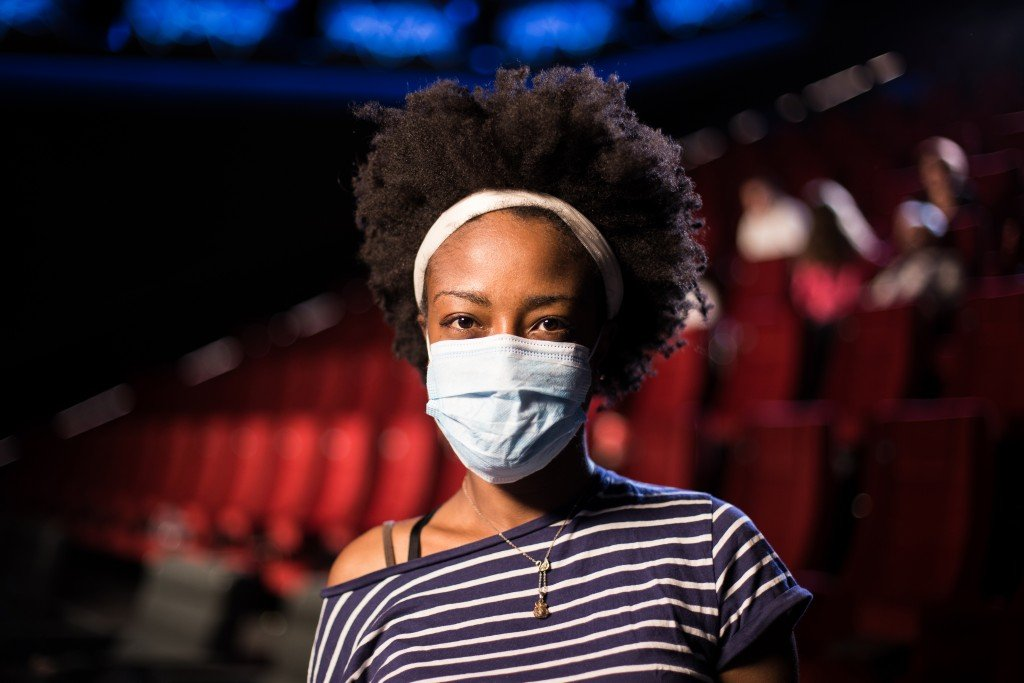 Portrait Of A Young African American Woman With A Protective Mask At The Cinema